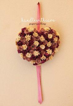 Fiocco nascita in paper quilling realizzato con rose e fiori di carta. Paper flower
