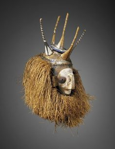 Africa | A mask from the Yaka peoples of DR Congo | ca. 19th to early 20th century | Wood, raffia, pigments and vegetable fibers.