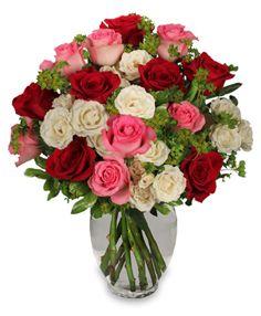Included in This Arrangement    Classic Urn Vase  Foliage: Variegated Pittosporum  White Spray Roses  Red Roses  Pink Roses  Bupleurum