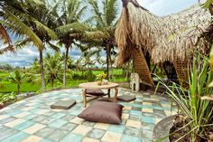 Patio with view of the rice fields and the sound of the running stream below.    pedras para uma area de lazer?