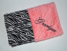 This listing is for 1 Minky Baby Blanket: Black and White Zebra print minky on one side and Coral Peach Minky Dot on the other.  This blanket is approx. 29 x 35. It is Perfect for a crib, car seat or stroller. Blankets are zigzag topstitched to increase stability and wear. Each blanket comes wrapped in a satin ribbon with a tag containing care instructions. ***You have the option to PERSONALIZE the time of purchase. At checkout, please leave the following info in the notes to seller Box: 1)…