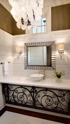 Wrought iron under the sink area gives this bathroom a gorgeous look ❤️