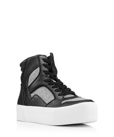 Please note, no further discount codes can be applied to this productGive your casual wardrobe a luxe upgrade with these Bosley sneakers from New York label, DKNY. Fashioned in a striking mix of textile and leather, they boast of-the-moment chunky flatform soles and a sporty-chic hi-top cut. Plus, the black, grey and white colourway will pair with all your favourites.Platform height: 3cmMaterials: upper - textile and leather, lining - textile, sole - syntheticEssential details: black leather…