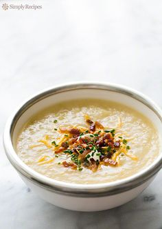 Love loaded baked potatoes? Then you'll love this baked potato soup, with classic toppings of crispy bacon, sour cream, chives, and cheddar ~ SimplyRecipes.com