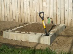 Cinderblock raised beds. I think this is my answer for cheap raised beds! I can get 16 blocks at Lowes for about 40 bucks. That's enough for one 4X8 bed! And I can put soil in the blocks and plant sprawling plants or herbs!