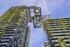 Completed in 2014, One Central Park in Sydney, Australia, includes two towers with vertical landscapes created by botanist Patrick Blanc. The 34-story residential tower is distinguished by a cantilever with a motorized heliostat that shines light onto the park below.