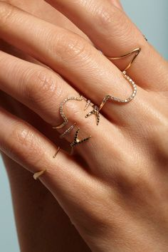 The Pave Diamond Collection is the simple, yet strikingly graphic shapes from the Contour Collection, elevated with delicate pave diamonds. Understated as a single, and a statement when stacked with e