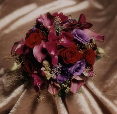 Bridesmaid  hand-tied style bouquet mostly jewel tones Photo by Judy Eliyas & Studio 925