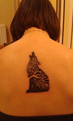 My (first) tattoo. ^^ I love it! It was a gift from my little brother. It's a first picture of it, a few hours after tattooing. tattoo, wolf, wolftattoo, back, short hair