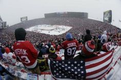 Peter Canepa of Grand Rapids, left, sports a Pavel Datsyuk as his friend Nate Hamel of Big Rapids holds up the American flag before the 2014 Bridgestone NHL Winter Classic at Michigan Stadium.