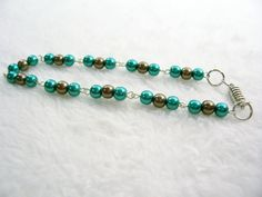 Turquoise and Bronze Eye Pin Bracelet