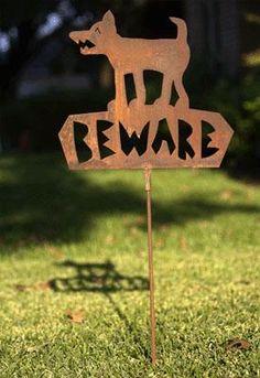 Rustic rusty Beware of Dog sign