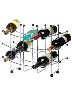 The Oenophilia Fusion 15 Bottle Wine Rack is crafted of durable metal with a contemporary grid-like design and sleek silver finish. This sturdy wine. Bottle Wall, Home Office Lighting, Wine Bottle Holders, Floor Care, Italian Wine, Wine Storage, Chrome Finish, Home Decor, Wine Racks