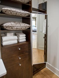 A full-length mirror can be pulled out when trying on clothes or tucked away when not in use.