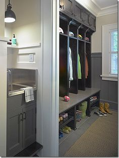 A separate mud room for the kids' coats and shoes.  I like the idea of a sink in the mud room – to wash up before they come inside with dirty hands.  It looks like there is a built in step to the sink for the little ones.