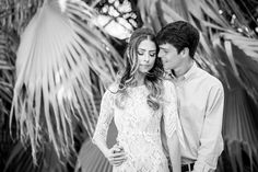 Desert Willows Engagement Photos in front of palm trees in Palm Desert, black and white moody and candid engagement photo idea by Cavin Elizabeth Photography