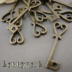 10 Antique Bronze Alice in wonderland Heart Key Charms Steampunk DIY   eBay  attach keys to ribbon for boutonnieres, add to bridesmaids bouquets for theme.