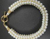 Golden cream pearl bracelet by BeadingMyWay on Etsy, $14.00 USD