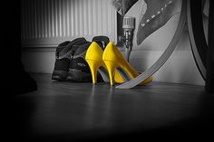 high contrast by using a color with a black and white background. Shades Of Yellow, Mellow Yellow, Orange, Black N Yellow, Splash Photography, Color Photography, Black And White Photography, Yellow High Heels, Yellow Shoes