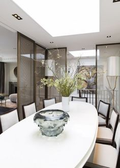 CONTEMPORARY DINING ROOM |  An unique dining room decor with pastel color by the famous interior designer Jean Louis Deniot| www.bocadolobo.com #diningroomdecorideas #moderndiningrooms