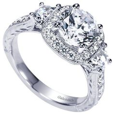 Vintage Halo 3-Stone Plus 2.35cttw Diamond Engagement Ring with Trapezoid Side Diamonds. This stunning mounting features .85cttw of accent diamonds, including t