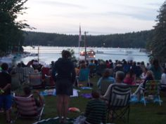 July 4th fireworks over Lake Sunapee harbor. The crowd gathers waiting for darkfall. A fun tradition in New Hampshire.