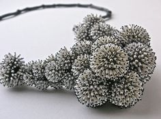 """""""Frozen"""" necklace by Sam Tho Duong, 2011. Silver, rice grain-shaped freshwater pearls, nylon."""
