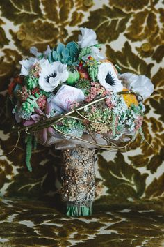 eclectic and unexpected bouquet, photo by Blake Loates http://ruffledblog.com/intimate-edmonton-wedding #anemones #succulents #flowers