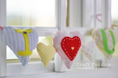 """Love is in the Air Garland. This """"Love is in the Air"""" Garland is a sweet Valentine's Day decoration. Learn how to make a garland with this easy sewing project. Stuff each of the little hearts on this DIY garland with scented potpourri or dried flowers. Valentine Day Love, Valentine Day Crafts, Scented Sachets, Valentine's Day Crafts For Kids, Heart Garland, Sewing Patterns Free, Free Sewing, Free Pattern, Valentines Day Decorations"""
