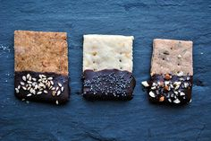 Sweet and Savory Chocolate Dipped Crackers: (From Left to Right) Spicy Chili Cornmeal Cracker with Toasted Sesame Seed, Lemon Cracker with Poppy Seeds and Rosemary Wheat Crackers with Sea Salt and Almonds