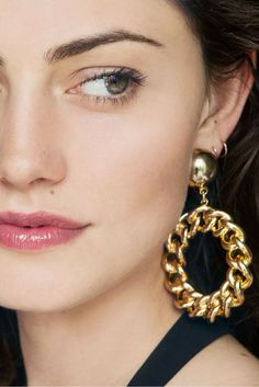 Statement earrings pair well with simple, glowy makeup