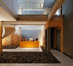 디자인 사무실의 돌, 철망, 벽돌인테리어 브라질 상파울로에 위치하고 있는 디자인회사 C...
