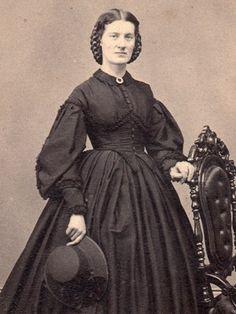 wide braid around head, black collar