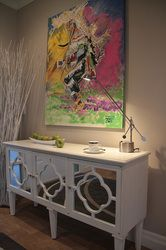 Great White Console Table With Mirrored Quatrefoil Doors. Art By Brander McDonald  Professional Interior Design And