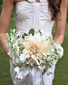 The Bridal Bouquet (MSW)    A dinner-plate dahlia, hydrangeas, and rosemary -- a symbol of love -- come together beautifully in the bridal bouquet.    Read more at Marthastewartweddings.com: Real Wedding: Susan and Rob, New Marlborough, Massachusetts