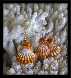 A gorgeous three piece set of brightly colored orange and white tiger stripe Hawaiian Sunrise Shells with Sunrise Shell chips. The flawless pendant shell measures 1 1/8 inches with exquisite detail, pristine in every way! The chips arranged atop the shell are stacked in natural and sexy slant, so unique! The pendant drapes from a 17 inch 14K gold filled flat cable chain necklace. Each earring Sunrise Shell is 3/4 inch in size with a stack of bright chips and coordinating  Swarovski Crystals.