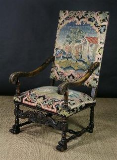 Carved 17th Century armchair covered in stumpwork and petit point