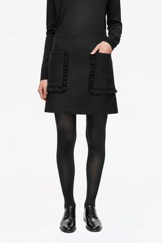 COS image 2 of Skirt with frill pockets in Black
