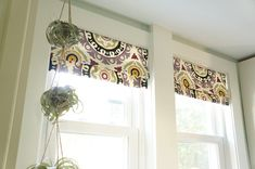 Sorry for starting off the post with a really bad pun (I'm really not sorry) but it's been stuck in my head the entire time I was putting this project together. Faux roman shades! and t…