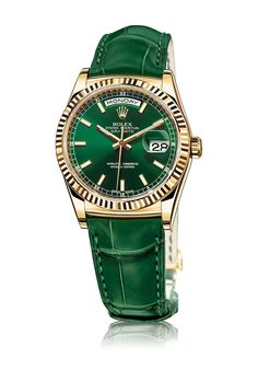 "New Rolex Day-Date Watch: Baselworld 2013  - Rolex proves that ""Green Is Good"" with this beautiful emerald green time-piece. Self winding with perpetual movement, this watch operates on your time.  http://www.rolex.com/watches/baselworld-2013/new-day-date.html"