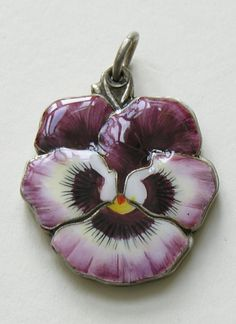 http://redrobinantiques.com/images/Enameled%20Pansy%20800%20Silver%20Slide%20Mirror.jpg