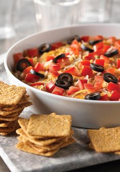 Fiesta Dip -- In need of an appetizer for your next get-together? Look no further than this easy, cheesy Fiesta Dip recipe!