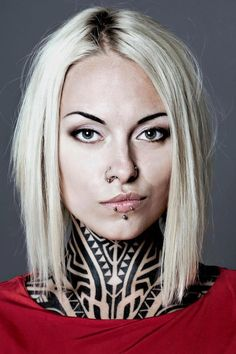 Neck tattoos + Piercing + straightened hairstyle. <3 Contact us for more information on how to become a tattoo artist today! Get more details at www.tattooschool-art.com.
