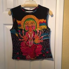 Sleeveless top by Chaudrey Sports-Small-NWT! Sleeveless top by Chaudrey Sports-Small-NWT! Sparely sequins and beading on the front. Very colorful, and cute. Tops Tank Tops