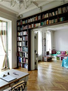 Every reader and writer's dream! Only I'd need a sliding ladder due to my shortness. ;)