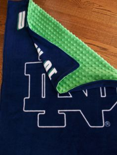 Notre Dame Blanket for Baby, Navy Fleece with Green Minky Dot. $35.00, via Etsy