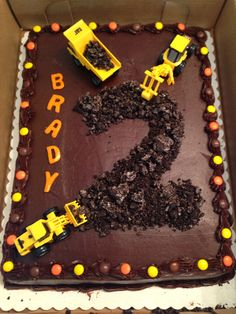 Construction birthday cake. Airheads for the letters, crushed Oreos for the 2, mini Cat trucks from Amazon, and Reece's Pieces for the border. Otherwise a plain frosted cake