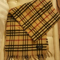 Authentic Burberry Classic Plaid Scarf Beautiful and classy Burberry Scarf, in 50/50 cashmere and wool blend. This gently loved scarf is super soft and in good condition. There are 3 very small and minor holes, however not visible when worn. Priced super low as there minor flaws on the scarf- shown on the last photo. No trades but open to offers. Burberry Accessories Scarves & Wraps