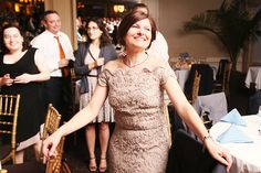 Mother of the bride looking at her daugher having fun dancing | Beautiful wedding reception in the Inn at Longshore Wedding in Westport, CT | Awards winning New Jersey Wedding Photographer Anna Rozenblat