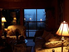 Warm and comfy living room from where to look at foggy mountains